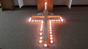 cross surrounded by lights