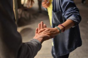 one person stretching their hand out to another