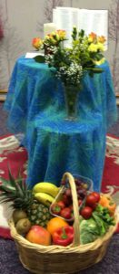 FRUIT FLOWERS AND A BIBLE